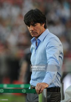 Germany's head coach Joachim Loew looks down ahead of the Germany vs Brazil international friendly football match at the Mercedes-Benz Arena in Stuttgart, southern Germany, on August 10, 2011. Germany won the match 3-2.