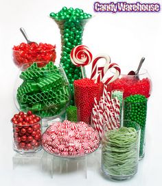 Christmas Candy Buffet    Add a sweet touch to your holiday parties and events with a delicious assortment of candies featuring the colors of red, white, and green! Shown here are chocolate covered almonds, cinnamon hard candy sticks, ribbon candy, gummy bears, swirl suckers and twist lollipops, taffy, peppermints, chocolate balls, sour strings, candy canes, and rock candy.