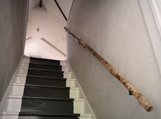 tree branch as a stair rail - a simple and beautiful solution (via Remodelista)
