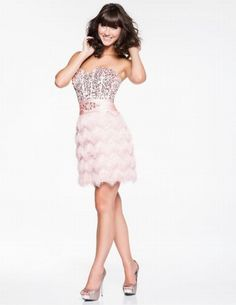 Light pink dress with feather detail on skirt - Nina Canacci Rehersal dinner dress?