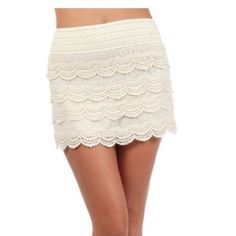 Lace layered skirt CROCHET LACE LAYERED SKIRT WITH BANDED WAIST  Cream.  **** available in sizes ( S/M M/L) let me know what size you need and I will add it to the listing *** Skirts Mini