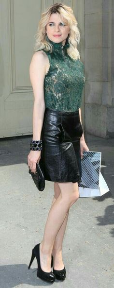 Green lace top and black leather skirt outfit
