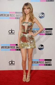 In Julien Macdonald at the 2013 American Music Awards. See Taylor Swift's full fashion evolution, from sequins in 2007 to her many crop tops today.