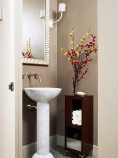 Adopt Zen Thinking        Leave only what you absolutely need in a small bathroom: a few hand towels, a bar of soap, and extra toilet paper stashed away in a slim storage unit. A pedestal sink saves space and is a showstopper in marble.