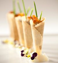 Windows Catering Co. presents an utterly elegant wild mushroom parfait in a savory cone with a chive sprig and lobster mushroom chip.