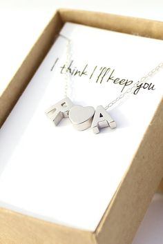 """""""I think I'll keep you"""" silver initial and heart necklace."""