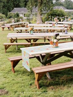 Picnic tables at Emily and Justin's picnic wedding reception.