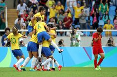 Home-team happiness:     Brazil players celebrates after scoring a goal during the first half against China on Aug. 3 at Estadio Olimpico Joao Havelange in Rio de Janeiro.