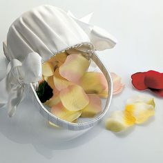 The Silk Rose Petals come in a variety of colors and are able to complement almost any wedding color scheme. Your Flower Girl will love tossing these delicate petals to signal your impending walk down the aisle. Our high quality imitation petals are a transportable, easy-to-clean alternative to fresh or dried petals. Available for purchase online at http://madelinesweddings.weddingstar.com/product/silk-rose-petals