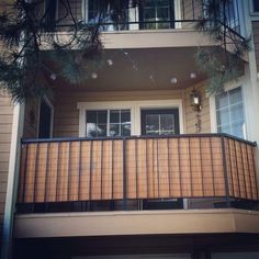 Bamboo blinds for balcony privacy - genius Darian and Kyle!!!