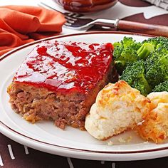 Moist & Savory Meat Loaf Recipe -Stop searching for a go-to meat loaf recipe. This is it! Your family will be delighted with this mixture of beef, pork and sauteed onion, with a sweet- and-tangy sauce baked onto the top. Cheese crackers are the secret ingredient in this one. —Simple & Delicious Test Kitchen