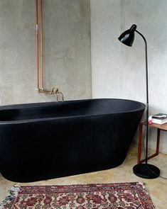 World's Most Beautiful Bathtubs Matte black tub. Black Bathtub, Black Tub, Bathroom Black, Bathroom Sinks, Copper Bathroom, Bathroom Closet, Black Floor, Industrial Bathroom, Concrete Bathroom