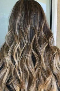 A rooty brunette with sunkissed highlighted ends.