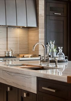 "This stone is called ""White Macaubas"", otherwise known as ""Aspen White"". It is a natural quartzite. Interior Design by Exquisite Kitchen Design."