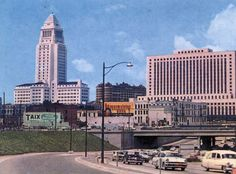 Postcard view looking southwest toward downtown showing Taix French Restaurant on Commercial Street with City Hall in the background and the newly construct 101 Freeway at lower-right, Los Angeles Area, Downtown Los Angeles, Commercial Street, California City, Ocean Park, Old Street, City Of Angels, Los Angeles County, City Streets