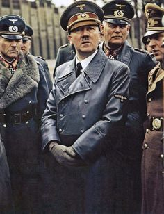 This is a fuller frame of an original color photograph taken by Walter Frentz (1907-2004) of (left to right) Heinz Guderian, Adolf Hilter, and Wilhelm Keitel, along with others at the Wolf's Lair military headquarters at Rastenburg in East Prussia.