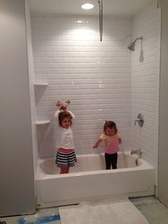 We have a shower!  White beveled subway tile