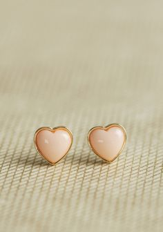 Sweet Side Heart Earrings 12.99 at shopruche.com. Give your look a simply sweet touch with these gold-toned heart earrings featuring peachy-pink centers.0.4