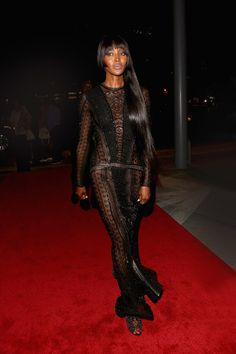 Naomi Campbell in a black sheer gown