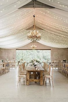 30 Adorable Wedding Reception Decorations ❤️ wedding reception decorations in a barn the ceiling is decorated with a white cloth with lights and chic golden chandeliers and long tables charlotte elise events via instagram ❤️ See more: http://www.weddingforward.com/wedding-reception-decorations/ #wedding #bride #weddingdecor #weddingdecorations #weddingreceptiondecorations