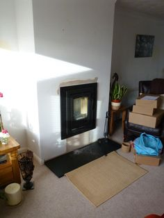 The Contura i4 is a small wood burner, the four sided frame is perfect for raising it up a wall.    #contura #i4 #modern #sided #frame #inset #fire #stove #wood #burner #wall #chimney #breast #hearth #kernowfires #wadebridge #redruth #cornwall