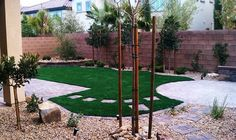Desert Greenscapes - Pet Friendly Back Yard with Syn Grass, Pavers & water wise landscaping. Designed by Donald Moore, Installed by Julian Hernandez - Las Vegas, NV, United States Dog Friendly Backyard, Dog Backyard, Desert Backyard, Backyard Paradise, Backyard Retreat, Backyard Ideas, Water Wise Landscaping, Landscaping Las Vegas, Landscaping With Rocks