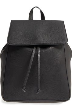 Swooning over this classic black faux leather backpack that is perfect for carrying the essentials around town or around campus.
