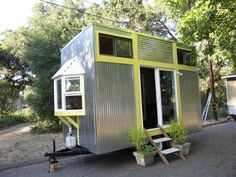 Tiny house with granite counters even! Love the siding used on this one