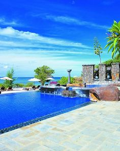 The Oberoi, Mauritius    Sun-bleached Hindu temples and fields of sugar cane set the scene on the ride to this dreamscape in the aqua Indian Ocean. The oceanfront villas are oh-so tranquil with four-poster beds and sunken tubs on the cusp of private walled gardens. And the common areas are just as divine. Dive into the serpentine infinity pool decorated with partially submerged statues of local goddesses, then recline on a pair of day beds looking out to Turtle Bay beyond.