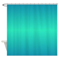 A turquoise or blue-green shower curtain with various shades of color in a horizontal position.