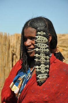 hair jewelry of woman in the Chari Logone River Cameroon