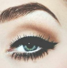 Delightfully Sinful-- love this pin up eye makeup! :: Pin Up Makeup:: Retro:: Big Bold Eyes:: Wing Tip Eyeliner:: Vintage Makeup
