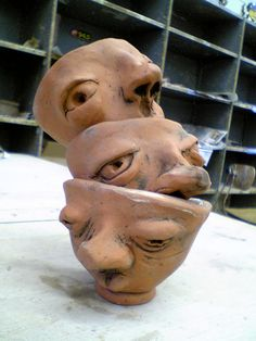 stacked pinch pot face cups