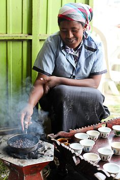 This woman is making some strong Ethiopian coffee- I can almost smell it from here! Woman near Debre Birhan, Ethiopia. Photo credit: Laura Cook.