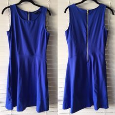 Deep lavender stretch fit and flare dress Gorgeous deep lavender stretchy fit and flare dress. Flares out at the bottom and is fitted on the top. 85% nylon, 15% spandex. Never been worn! Cynthia Rowley Dresses