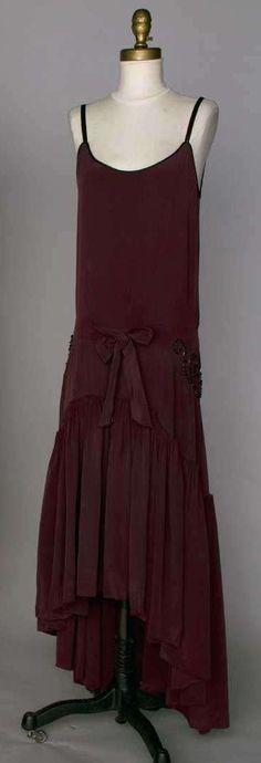 Evening Gown: ca. 1920's, silk, gunmetal beading at hips, deep cartridge pleated skirt flounce.
