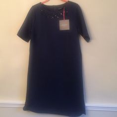 "NEW Cynthia Rowley Navy dress Size 6 New with tags, navy dress with  black crystals around neckline. Slit on each side is approx 3"".  94% polyester and 6% spandex. Machine washable. From top of back zipper to bottom of hemline is 33"" long. Size 6 Excellent quality Cynthia Rowley Dresses"