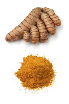 Fresh turmeric rhizome and a heap of ground turmeric powder on white background