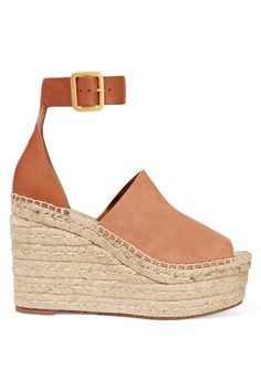 Tap the season's '70s vibe with Chloé's tan wedge sandals. They're designed with a braided jute heel modeled on traditional espadrilles and finished with soft suede and smooth leather straps. Continue the bohemian feel with a fluid top and culottes.