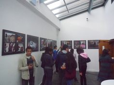 Exploring the art gallery. The young people take part in an art event as part of their Arts Awards portfolio.
