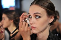 """Even the Models Were Gushing Over Christian Siriano's Russian Braids: The focal point of the beauty look backstage at Christian Siriano had to be the Russian-inspired braids. Fishtailed and twisted, the two plaits conjoined in the back for a feminine and elegant style.: The makeup, conjured up by MAC artist Polly Osmond, focused on a bold, black eye. The rest of the face was kept natural, save for some heavy contouring that gave models """"a sucked-in, sculpted look,"""" according to Osmond.Keep…"""