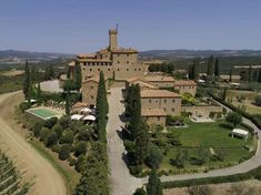 This hotel within an hilltop castle of golden stone is surrounded by vineyards and groves. All About Italy, Hotels, Dom, Palermo, Aerial View, Tuscany, Paris Skyline, Castle, Mansions