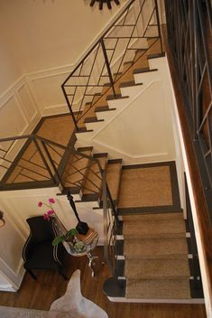 metal stair rail with fretwork.  seagrass runner.
