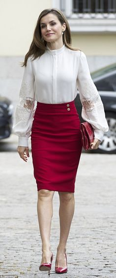 The Spanish monarch, 44, dazzled in a slim-fitting red pencil skirt teamed with matching stiletto heels and clutch today in Madrid, topped off with a white blouse with dramatic lace sleeves.