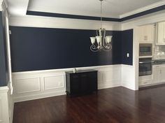 Absolutely love this navy blue color in our dining room.  Sherwin Williams Naval 6244 from the Pottery Barn collection.