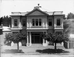 Opera House in Wanganui showing the entrances to the dress circle, stalls and pit. Two plane trees are in the foreground. Photograph taken by Frank J Denton. Plane Tree, Stalls, Maui, New Zealand, Opera House, Entrance, Photographs, Trees, Mansions