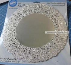 Silver doilies - so pretty! Thinking of using these at the head table under the plates. Cheaper than buying chargers.
