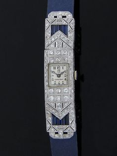 Swiss ladies art deco diamond and sapphire wrist watch in platinum. This watch features 86 pave set single cut and Old European cut diamonds at 2.73 carat total weight having VS1-SI1 clarity and G color, along with 8 channel set, custom cut baguette sapphires. This watch also has the original silver dial and a 17 jewel movement by Omega, circa 1920. Weight of the watch is 18.5 grams. Movement #6247285. Appraisal value is $13,452.