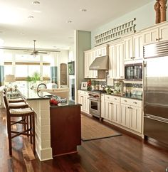 This is it. The kitchen I have been looking for. Everything on one wall with a huge island that has the dishwasher and sink.
