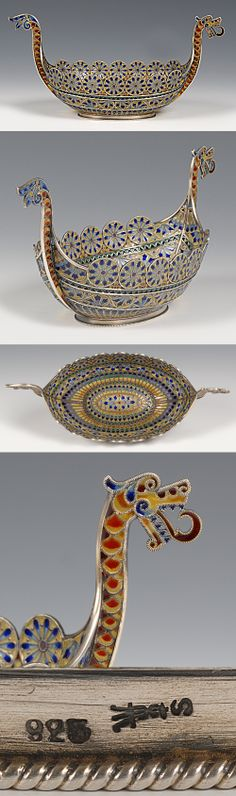 A Norwegian silver gilt and plique-a-jour enamel viking boat, David Andersen, circa 1900. Of traditional form, the boat decorated with translucent shades of red, green, yellow and blue enamel with flower inspired round shields around the upper rim, finished with a dragon's head and tail.